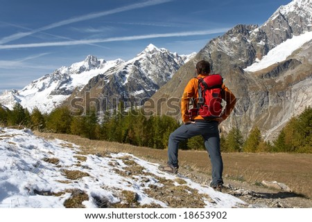 Male hiker enjoying the view over the beautiful landscape of Mont Blanc, Courmayeur, Italy - stock photo