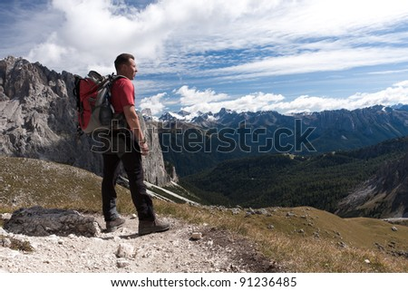 Male hiker enjoying the view over the mountains - stock photo