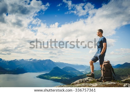 Male hiker on the top of a mountain - stock photo