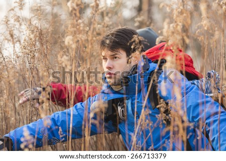 Male hikers in field - stock photo