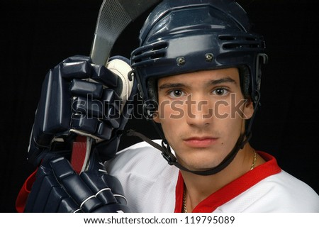 Male Hockey Player With Helmet, Stick And Gloves - stock photo