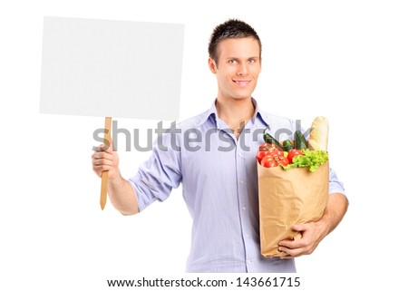 Male holding a paper bag and blank panel isolated on white background - stock photo