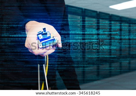 male holding several type of connector wire with sever room background - stock photo