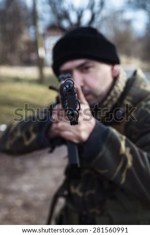 Male hunter aiming directly to the camera - stock photo