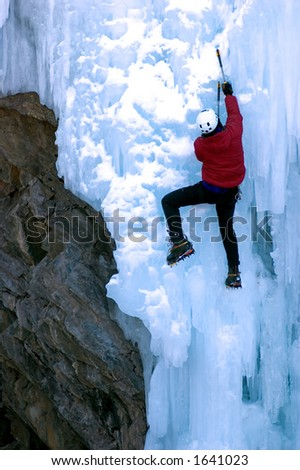 male ice climber ascending cauliflower like ice face - stock photo