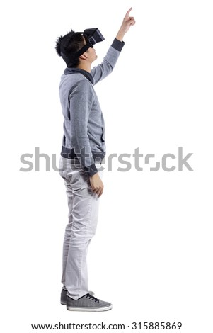 Male immersed in interactive virtual reality video game doing gestures on white background.  He is wearing a stereoscopic 3d vr headset.