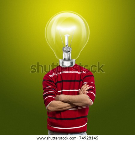 male in red and lamp-head have got an idea - stock photo