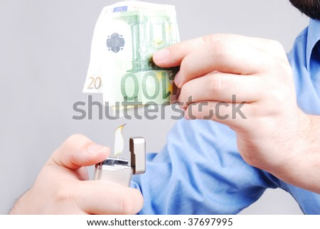 Male in shirt is about to burn one hundred euro - stock photo