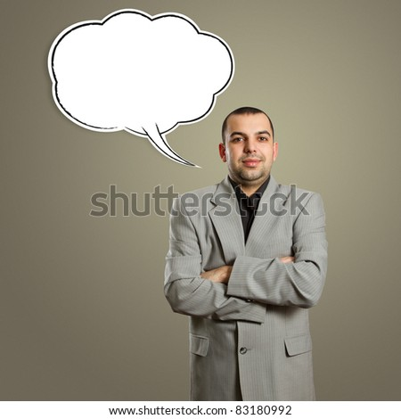 male in suit with crossed hands and speech bubble, looking on camera