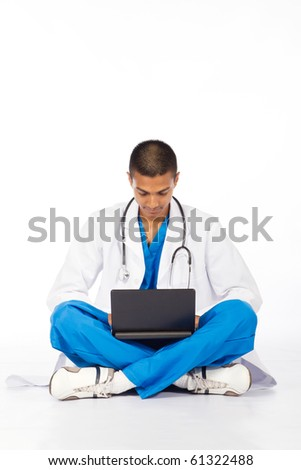 male Indian medical intern working on computer - stock photo