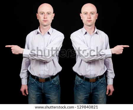 male isolated on black pointing finger - stock photo