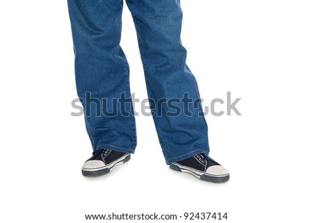 Male jeans and sports gumshoes. Isolated one white.