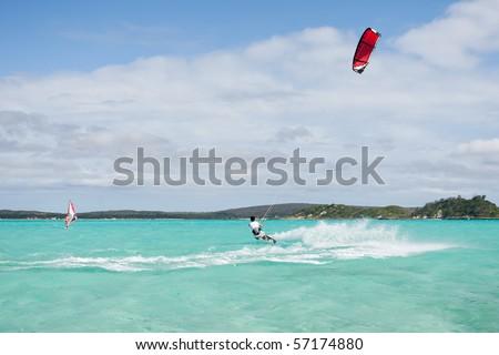 Male kitesurfer kitesurfing in the lagoon of Babaomby, Madagascar - stock photo