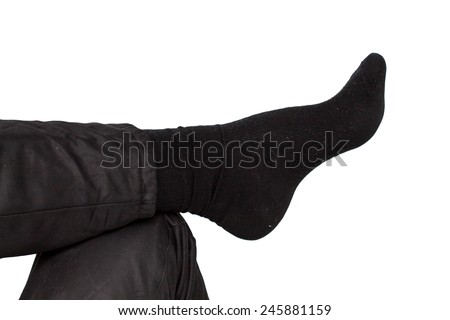 male leg and black socks on a white background - stock photo