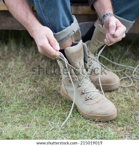male legs in boots. selective focus on shoe - stock photo