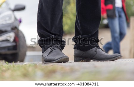 male legs in jeans and shoes