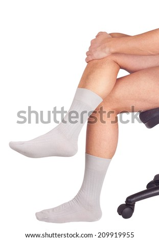 Male legs in socks. Isolated on white background - stock photo