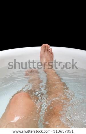 male legs in the bathtub.Selective focus - stock photo