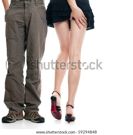 male legs near sexy female legs, male hand touching female buttocks, everything isolated on white background - stock photo