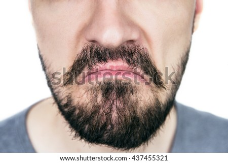 male lips with untrimmed beard at closeup.Close up of male part of face. sad,melancholy man.