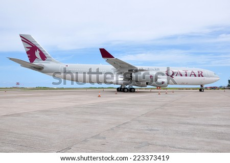 MALE, MALDIVES - SEPTEMBER 4, 2014: A Qatar Airways Airbus A340 at Ibrahim Nasir International Airport. Qatar Airways is the state-owned flag carrier of Qatar. - stock photo
