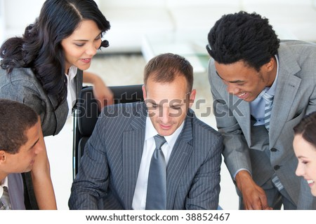 Male manager working with his business team in office - stock photo