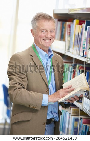 Male Mature Student Studying In Library