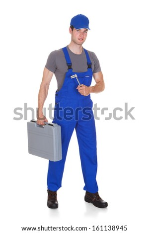 Male Mechanic Holding Ratchet And Toolbox On White Background - stock photo