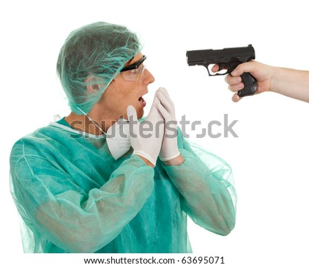 male medical doctor in green protective uniform, hat and gun