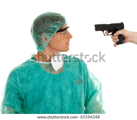 male medical doctor in green protective uniform, hat and gun - stock photo