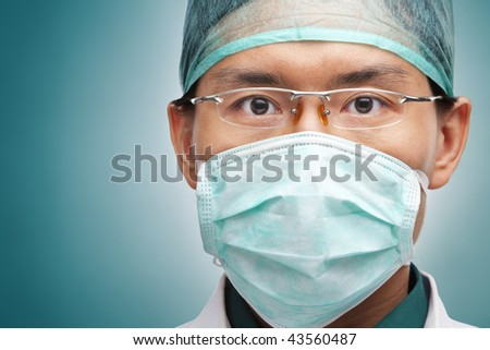 Male medical worker looking seriously to camera - stock photo
