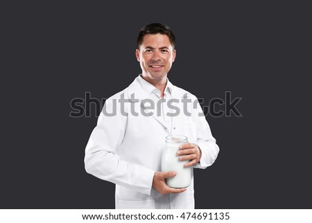 Male milk expert on dark background