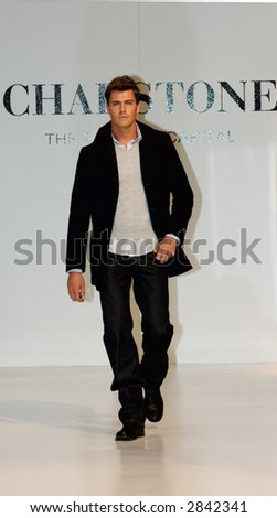 Male model at a fashion show - stock photo