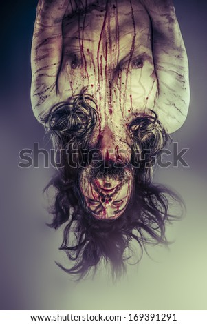 Male model hanging, evil, blind, fallen angel of death - stock photo