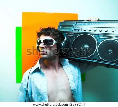 Male model holding Vintage radio