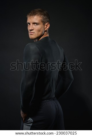 Male model in compression t-shirt  - stock photo