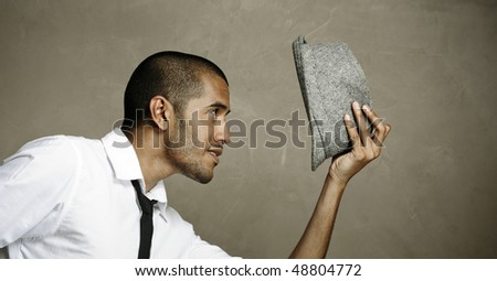 Male model is well pleased with his fedora - stock photo
