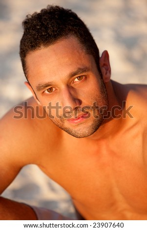 male model portrait at the beach looking serious