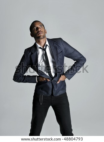 Male model poses with confidence in studio - stock photo
