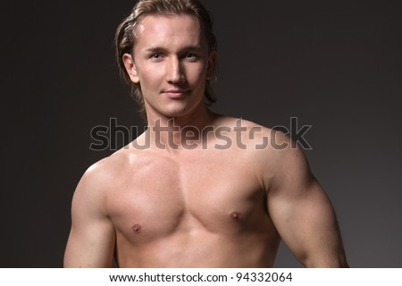 male model posing in the studio, showing the positive and the beauty of the figure - stock photo