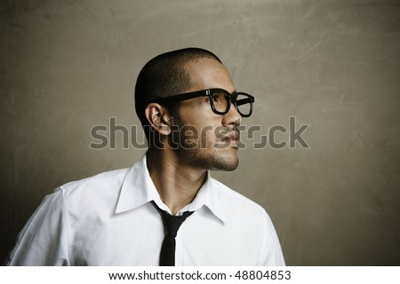 Male model pushes the boundaries with his nerd fashion expedition - stock photo