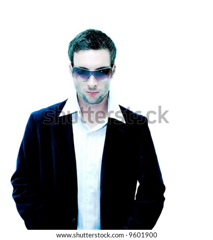 Male model standing looking down(extreme light for effect) - stock photo