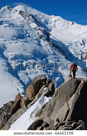 Male mountain climber, in background the summit of Mont Blanc - France - stock photo
