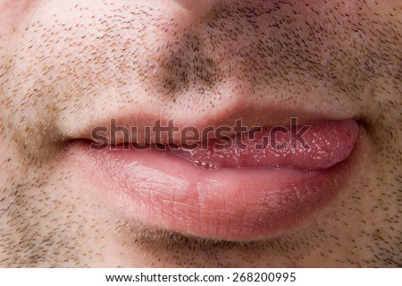Male mouth showing tongue - stock photo