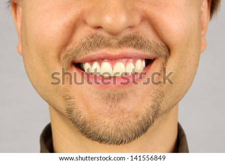 male mouth with a smile, beard and mustache - stock photo