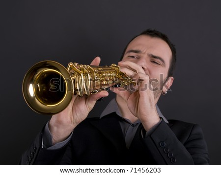 male musician playing strait soprano saxophone - stock photo