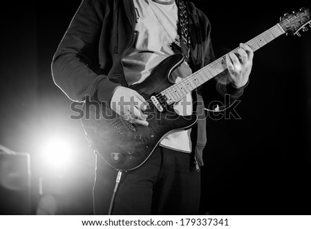 male musician with electric guitar