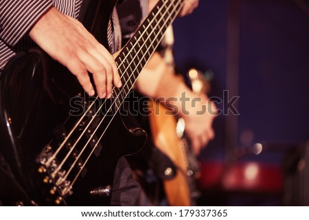 male musician with electric guitar - stock photo