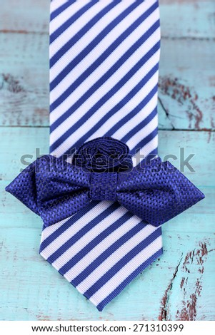 Male necktie and bow tie  wooden background - stock photo