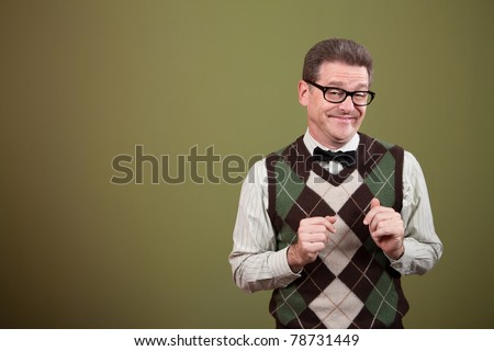 Male nerd with bowtie makes a face - stock photo
